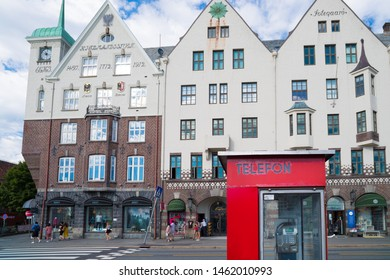 BERGEN, NORWAY - JULY 28, 2018: Detail of a red phone booth on the Bryggen promenade, the touristic hotspot of Bergen