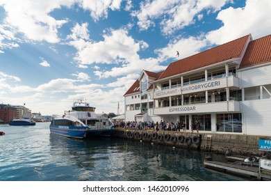 BERGEN, NORWAY - JULY 28, 2018: People boarding for a fjord cruise in the port of Bergen