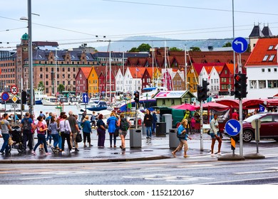 Bergen, Norway - July 30, 2018: City street view with Bryggen old wharf, people and colorful traditional houses