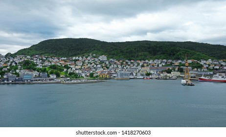 Bergen, Norway - July 30, 2018: Scenic views of Bergen, city and municipality in Hordaland on the west coast of Norway, entering the cruise ship terminal at Dokken, one of the two harbors in Bergen