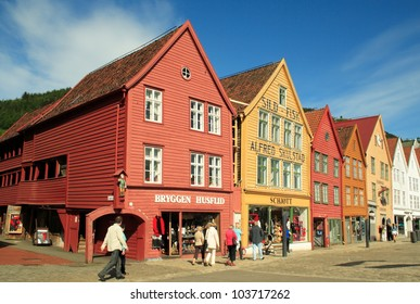 BERGEN, NORWAY - JUNE 5: Tourists and locals stroll along the UNESCO World Heritage Site, Bryggen, in the city of Bergen, on 5 June 2011. Bryggen is famous for its old wooden buildings and history.
