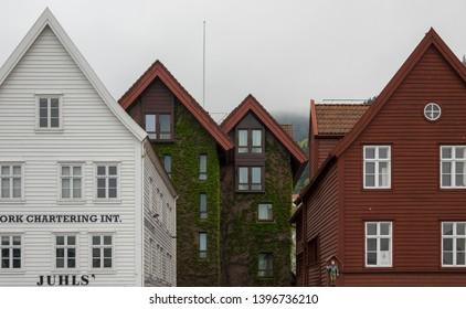 BERGEN, NORWAY - MAY, 2019: Historical buildings in Bryggen - Hanseatic wharf in Bergen, Norway. UNESCO World Heritage Site.
