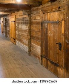 BERGEN, NORWAY - MAY, 2019: Historical buildings in Bryggen - Hanseatic wharf in Bergen, Norway. UNESCO World Heritage Site. Interior of ancient doors inside the wharf.
