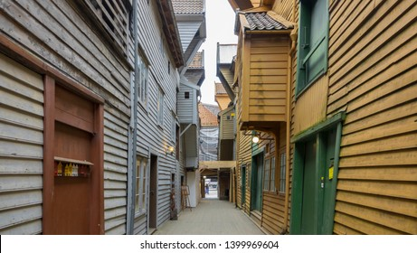 BERGEN, NORWAY - MAY, 2019: Historical buildings in Bryggen - Hanseatic wharf in Bergen, Norway. UNESCO World Heritage Site. Cozy narrow street in the middle of wooden houses.
