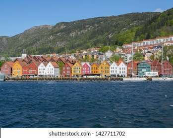 BERGEN, NORWAY - MAY, 2019: Historical colorful and bright buildings in Bryggen - Hanseatic wharf in Bergen, Norway. UNESCO World Heritage Site.