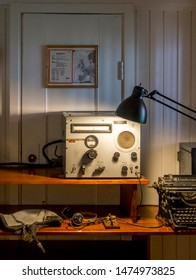 BERGEN, NORWAY - MAY, 2019: BERGEN, NORWAY - MAY, 2019: Bergen Maritime Museum exhibition - Radio operator's navigation cabin, electromagnetic telegraph system for morse code and vintage typewriter.