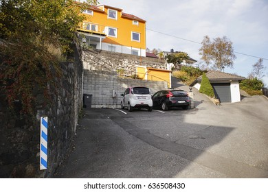 Bergen, Norway - October, 2016: Citroen C-zero and Volvo V40 at the charging station near the house