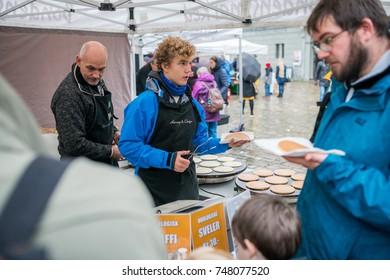 Bergen, Norway -  October 2017 :  Men selling delicious pancakes on the street food market