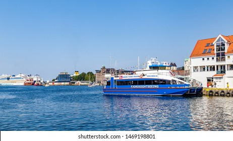 Bergen, Norway, Scandinavia - July 30, 2019: Fjord sightseeing boat ready for tourists in the port of Bergen in Norway