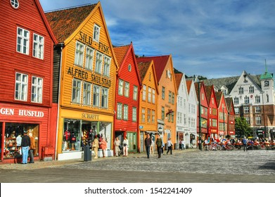 BERGEN, NORWAY, SEP 15: Colorful HDR image of the historical building at Bryggen quarter in Bergen on blue cloudy sky. Bergen, Norway, Sep 15, 2016
