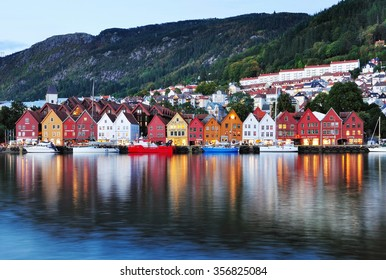 BERGEN, NORWAY - SEPTEMBER 27, 2013: Colorful wooden house of Bryggen Hanseatic Wharf at night, a UNESCO World Heritage site with shops, hotels, and restaurants.