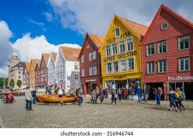 BERGEN, NORWAY - SEPTEMBER 5: Norway's most visited tourist attraction Bryggen on September 5, 2015 in Bergen. Bryggen is a row of old Hanseatic commercial buildings and a UNESCO World Heritage site.