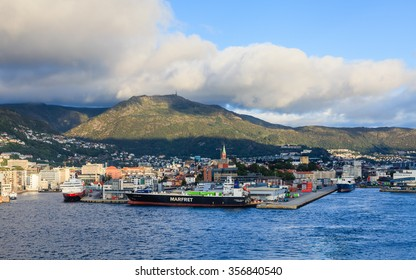 BERGEN, NORWAY - SEPTEMBER 7:  A view of the port of Bergen in Norway on September 7, 2015.  In the foreground can be seen the ro-ro cargo ship Marfret Niolon owned by Marfret shipping company.