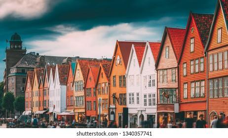 Bergen, Norway. Tourists People Visiting Historical Landmark Houses In Bryggen - Hanseatic Wharf In Bergen, Norway. UNESCO World Heritage Site. Famous Landmark. Destination Scenic