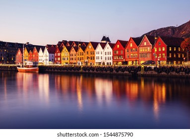 Bergen, Norway. View of harbour old town Bryggen in Bergen, Norway during the twilight. Famous illuminated landmarks at sunrise
