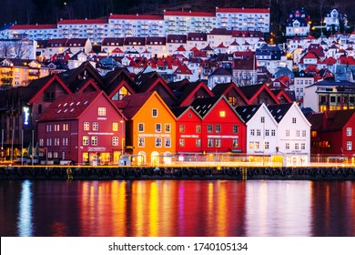 Bergen, Norway. View of harbour old town Bryggen in Bergen, Norway during the night. Illuminated famous landmarks with reflection in the water