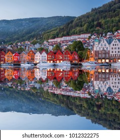 Bergen street at night with boats in Norway, UNESCO World Heritage Site