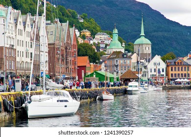 Bergen/Norway-August 21, 2014:Boats and shops along the Bryggen Hanseatic Wharf of Bergen