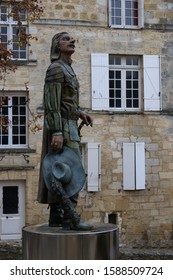 Bergerac, Dordogne/France 12/07/2019 The local statue of the fictitious character  Cyrano De Bergerac. Shown wearing his outfit of musketeer style clothing, No people due to local charity event today.