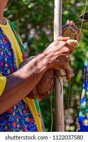 Berimbau player playing his instrument during typical folk festival in the interior of Brazil