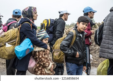 BERKASOVO, SERBIA - OCTOBER 17, 2015: Group of refugees, mainly children, waiting to cross the Croatia Serbia border, between the cities of Bapska and Berkasovo on the Balkans Route, during the Refuge