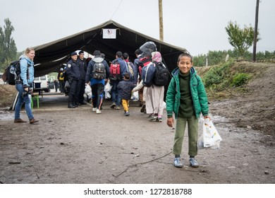 BERKASOVO, SERBIA - OCTOBER 17, 2015: Young refugee boy standing and waiting to cross the Croatia Serbia border, between the cities of Bapska and Berkasovo on the Balkans Route, during Refugee Crisis