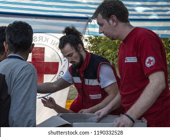 BERKASOVO, SERBIA - OCTOBER 3, 2015: Workers of the Red Cross of Serbia (Crveni Krst Srbije) providing aid at the border between Serbia and Croatia during the Refugees Crisis, on the Balkans Route