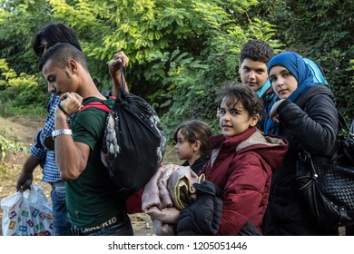 BERKASOVO, SERBIA - OCTOBER 3, 2015: Group of refugees, mainly children, waiting to cross the Croatia Serbia border, between the cities of Bapska and Berkasovo on the Balkans Route