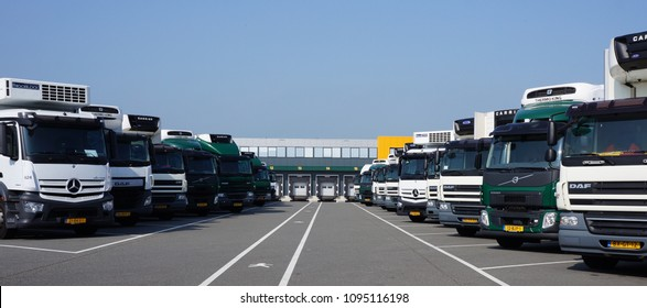 Berkel, the Netherlands. May 2018. Several DAF, Volvo and Mercedes trucks parked in front of a distribution center.