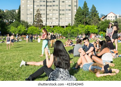 BERKELEY, CA- Apr 16, 2016: Students at the University of California Berkeley campus enjoying a warm spring day outdoors on the grass. The open green space is called Memorial Glade.