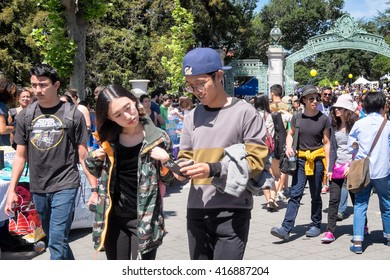 BERKELEY, CA- Apr 16, 2016: Crowds of students at the University of California Berkeley campus during a Spring open house known as Cal Day. The Sather Gate entrance is seen in the background.