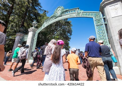 BERKELEY, CA- Apr 16, 2016: Crowds of university alumni, students and community visitors on campus for Cal Day, the annual open house, enter through Sather Gate, the main entrance. Low wide angle view