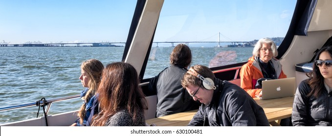 BERKELEY, CA- April 14, 2017: Passengers on a privately operated 20-minute commuter ferry to San Francisco. Many bring bicycles and ride to their offices after landing.