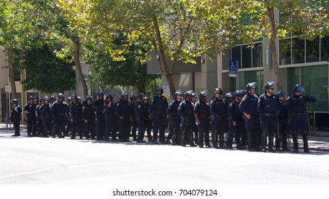 Berkeley, CA - August 27, 2017: Police in riot gear standby as the ??NO TO MARXISM IN AMERICA?� rally in Martin Luther King Jr. Civic Center Park proceeds, more counter-protesters than protesters.