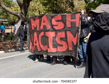 Berkeley, CA - August 27, 2017: Unidentified participants at the NO TO MARXISM IN AMERICA rally in Martin Luther King Jr. Civic Center Park, more counter-protesters than protesters.