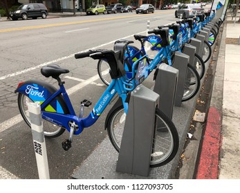 BERKELEY, CA - MARCH 16, 2018: A row of Ford GoBikes near Campus. The Ford GoBike system is the Bay Area's bike share program.