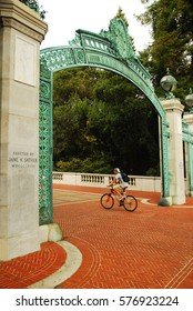 Berkeley, CA, USA August 19, 2008 A young man rides his bike through the historic Sather Gates on the campus of the University of California, Berkeley
