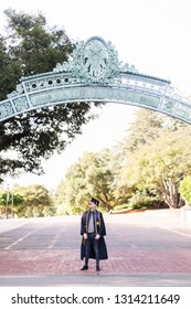 Berkeley, CA / USA - May 17th, 2018: UC Berkeley Graduate in cap and gown, portraits taken on campus.
