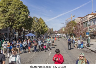 BERKELEY, CA, USA; OCT 23, 2016: Street fair on Shattuck Avenue in Berkeley with a focus on typical local businesses and open Storefronts.