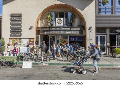 BERKELEY, CA, USA; OCT 23, 2016: Epicurious Garden at the Street fair on Shattuck Avenue in Berkeley with a focus on typical local businesses and open Storefronts.