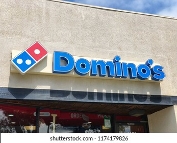 BERKELEY, CA, USA - SEP 2, 2018: Domino's Pizza Store front with and blue franchise sign.