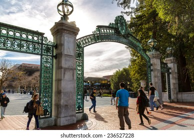 BERKELEY, CA-DEC 8, 2014: University of California at Berkeley at the main entrance into the campus. Students are shown walking under the historical landmark, called Sather Gate.
