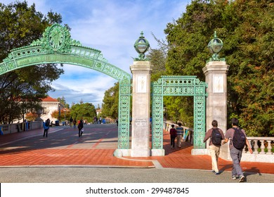 BERKELEY, CA-DEC 8, 2014: University of California at Berkeley at the main entrance into the campus. Students are shown walking under the ornate passageway, called Sather Gate, built in 1910.