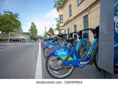 Berkeley, California - April 14 2019: Ford GoBikes awaiting riders in a Berkeley neighborhood