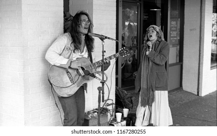 Berkeley, California / USA - December 14, 1985: Two buskers playing for tips on Telegraph Avenue in Berkeley, California on December 14, 1985.