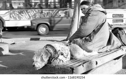 Berkeley, California / USA - December 14, 1985: A homeless woman and her dog resting on a bench on Telegraph Avenue in Berkeley, California, on December 14, 1985.