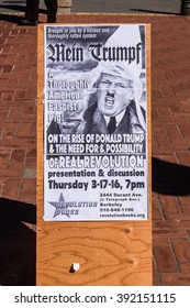 Berkeley, California, USA - March 16, 2016: A poster with caricature of Donald Trump, compares Donald Trump to Adolf Hitler, wearing a hood of the KKK, at the University of California, Berkeley.