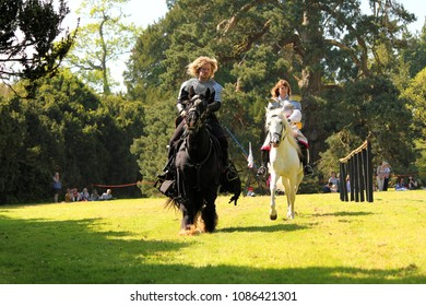 Berkeley, England - May 6, 2018: Medieval Jousting Show in Berkeley Castle. The history played out within Berkeley Castle's walls make it one of the most remarkable buildings in Britain.
