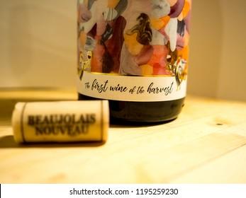 Berkeley Heights, NJ / USA - 11/18/2017: close-up of Beaujolais Nouveau bottle and cork