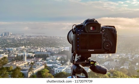 Berkeley, United States - July 12, 2018: Canon 5D Mark IV set up on a Manfrotto tripod at Grizzly Peak in Berkeley Hills pointing at San Francisco covered with fog at sunset